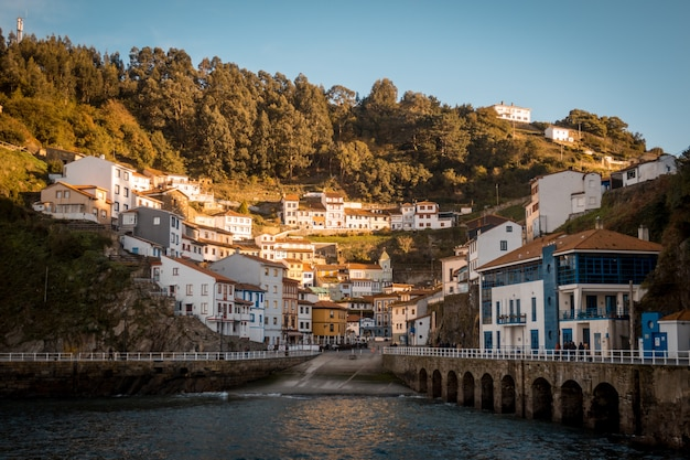 Beautiful view of the buildings of cudillero, asturies in spain surrounded by hills