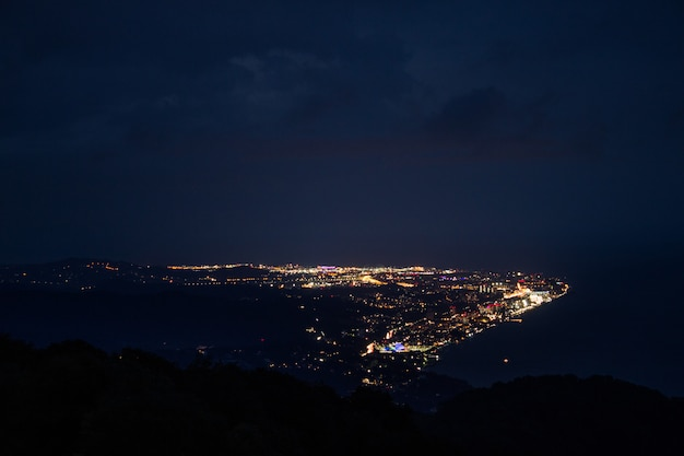 Beautiful view of the city at night from a great height from the mountains