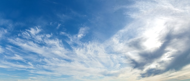 A beautiful view of a cloudy blue sky. the clouds are closing the sun.