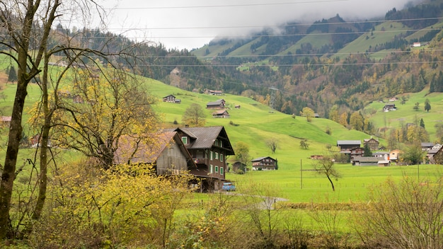 Beautiful view of countryside village and mountain at autumn in engelberg, switzerland
