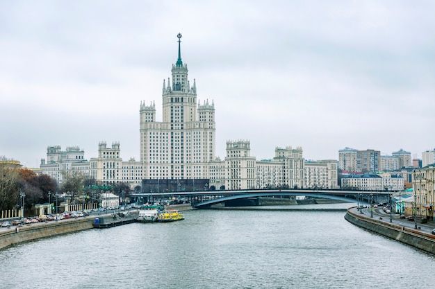 Beautiful view of the embankment and architecture in the center of moscow on a cloudy autumn day.