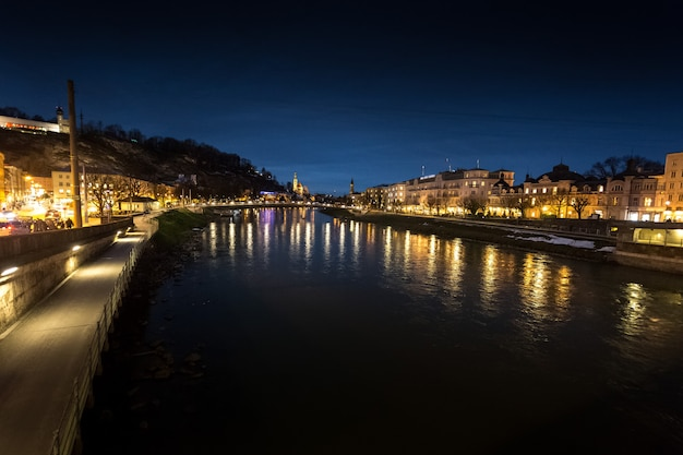 Beautiful view from bridge on river salzach at salzburg at night