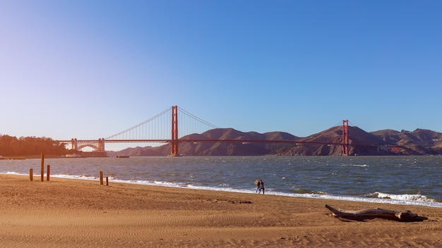 Beautiful view from crissy field beach of famous golden gate bridge in the light of the setting sun