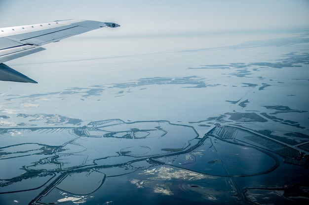 Beautiful view from the plane to the swampy places near venice italy