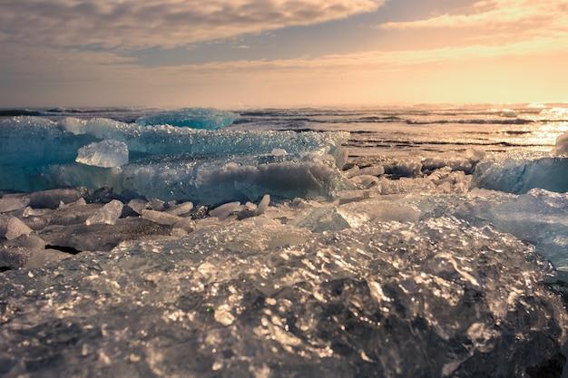 Beautiful view of iceberg at jokulsalon glacier lagoon beach in iceland during sunset