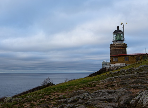 Beautiful view of kullaberg lighthouse in sweden with ocean and cloudy sky