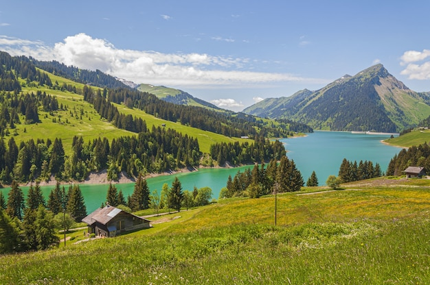 Beautiful view of a lake surrounded by mountains in longrin lake and dam switzerland, swissalps