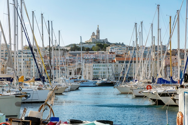 Beautiful view of the marina and notre dame in marseille. bright sunny day. great landscape.