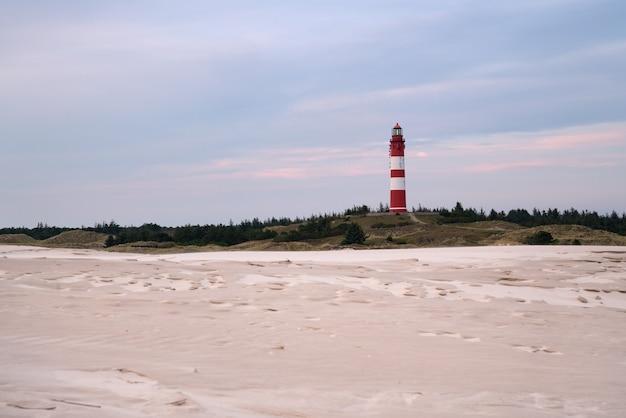 日没時のウィットデュン灯台、アムルム島、ドイツの美しい景色