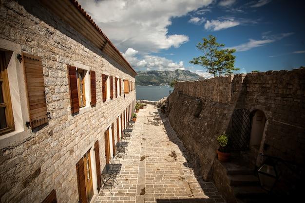 Beautiful view of old narrow street at mediterranean seaside city