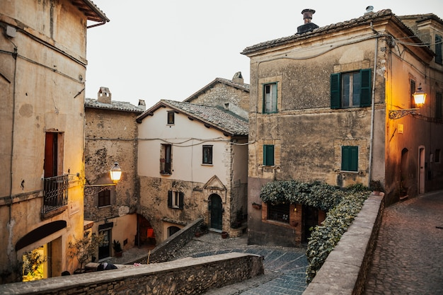 Beautiful view of old traditional houses and idyllic alleyway in the historic town province of viterbo, lazio, italy.