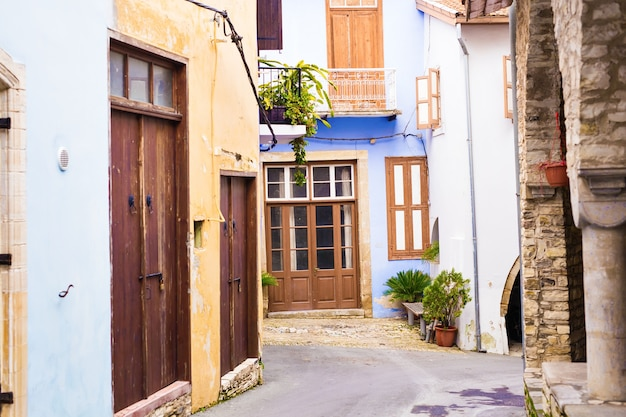 Beautiful view of scenic narrow alley with historic traditional houses in an old town in europe.