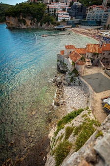 Beautiful view of  seaside old castle at city budva located on high cliff