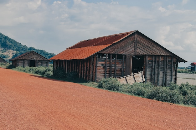 Beautiful view of several wooden barns in the countryside