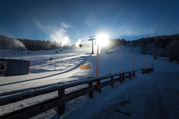 Beautiful view of ski slopes on resort at austrian alps