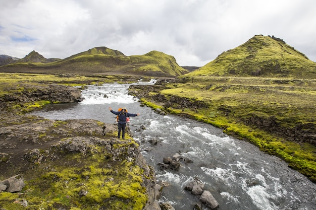Beautiful view of a tourist on the trekking path of landmannalaugar in iceland