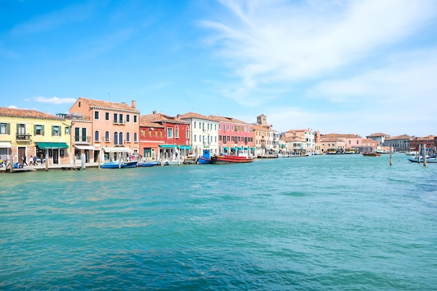Beautiful view of venice with coloured building on the seaand boats for family vacations