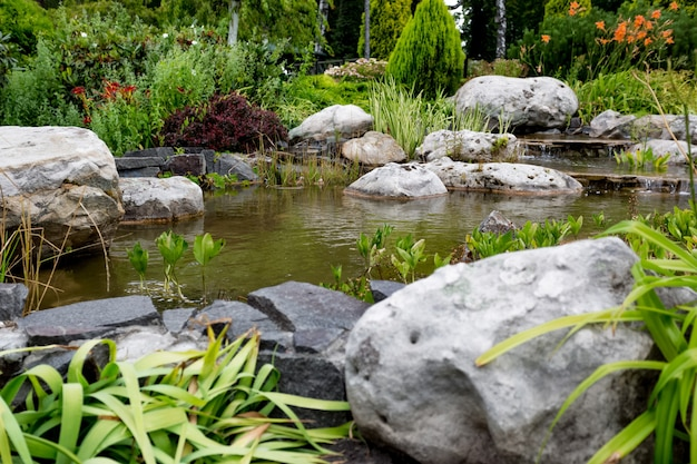 Beautiful view of water flowing through rocks in formal garden