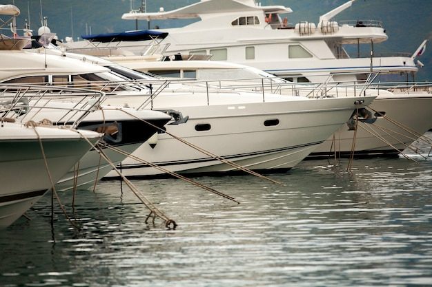 Beautiful view of white luxury yachts and boats moored at sea harbor