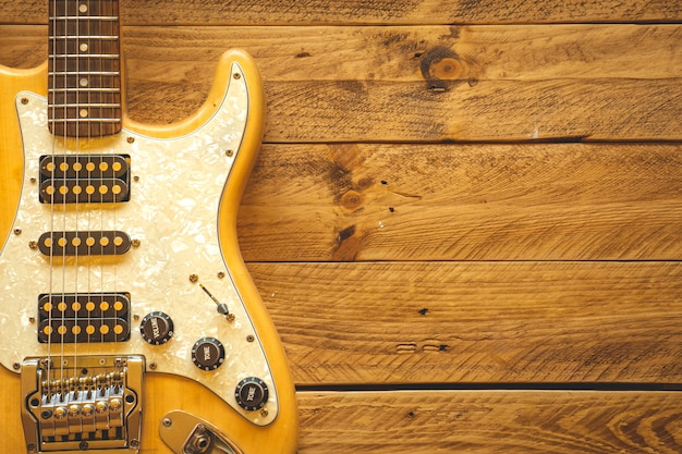 Beautiful vintage electric guitar on a brown wooden table
