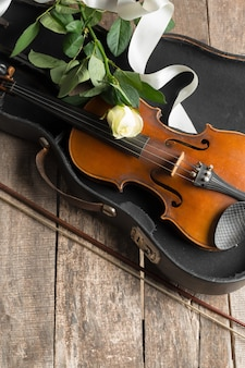 Beautiful violin with rose and ribbon