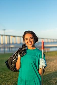 Beautiful volunteer woman posing in city park