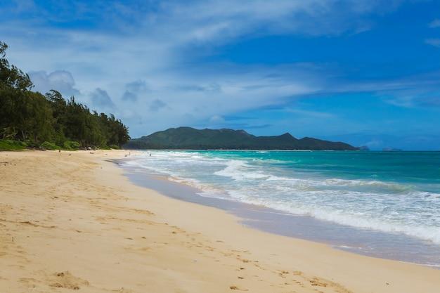 Beautiful waimanalo beach with turquoise water and cloudy sky, oahu coastline, hawaii