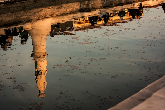 A beautiful water reflection of a historical monument in a typical italian city. artistic photo.