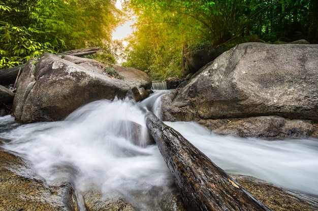 Beautiful waterfall in autumn forest of the stream in the natural park