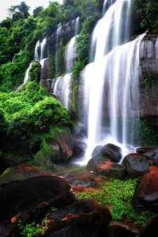 Beautiful waterfall background pictures tat phimanthip waterfall located in the northeast of thailand.