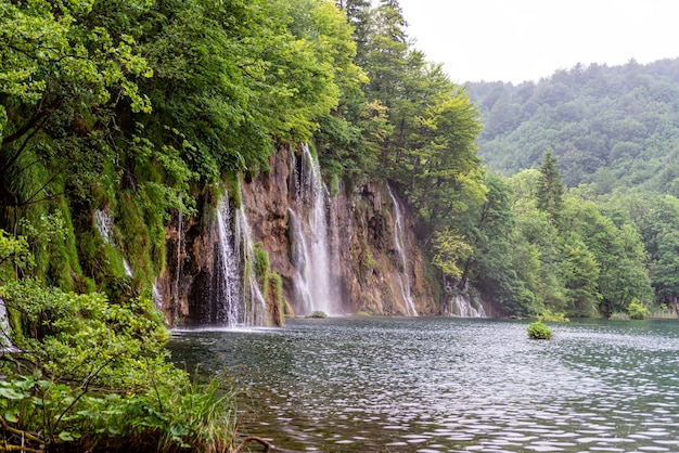 Beautiful waterfall and blue limpid lake in plitvice lakes national park, dalmatia, croatia
