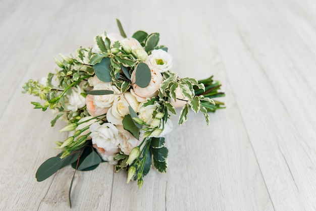 Beautiful wedding bouquet of the bride on a light background