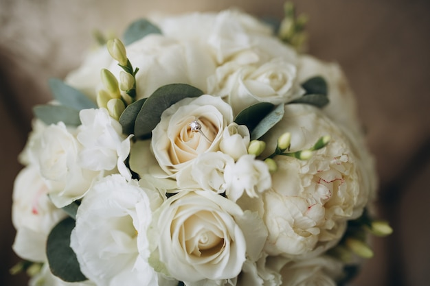 Beautiful wedding bouquet and golden rings