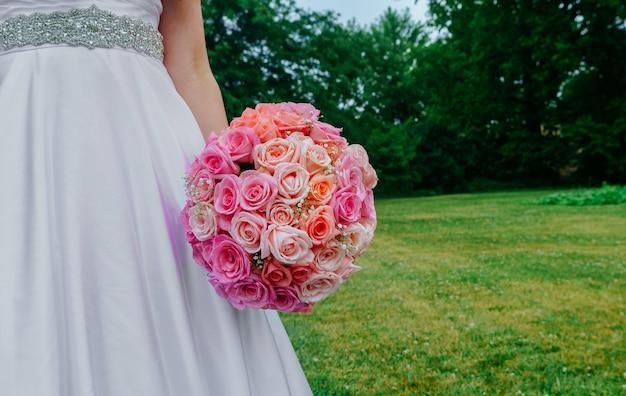 Beautiful wedding bouquet hands of the bride