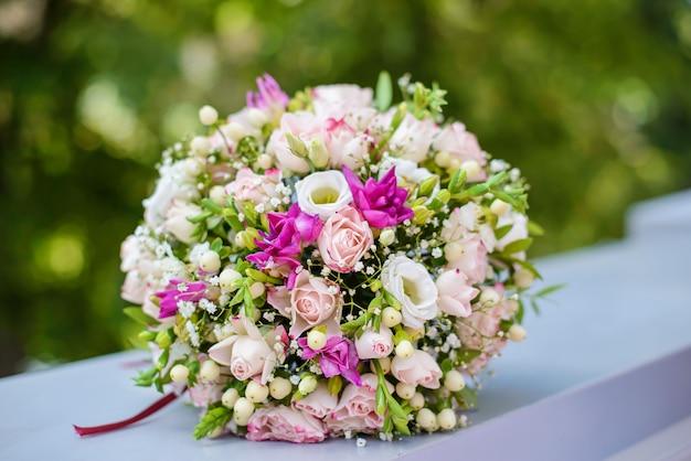 Beautiful wedding bouquet on the railing