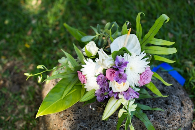 Beautiful wedding bouquet on the stone