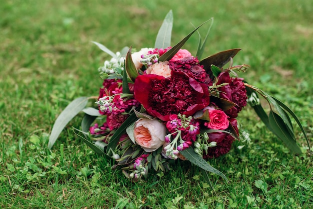 Beautiful wedding bouquet with red peonies