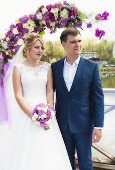 Beautiful wedding ceremony at riverbank at sunny day