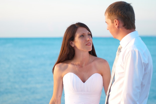Beautiful wedding couple bride and groom at the beach