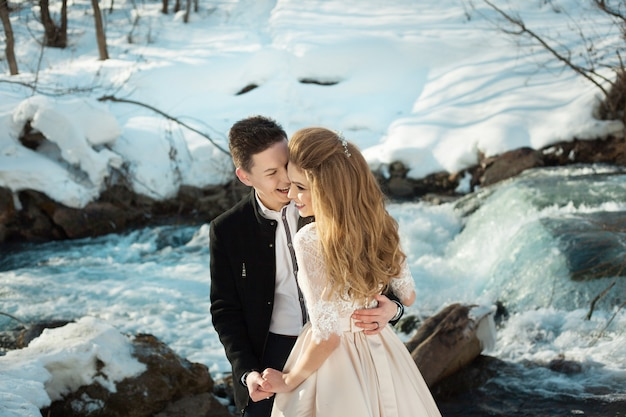 Beautiful wedding couple by the river