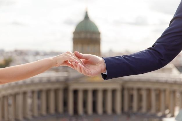 Beautiful wedding couple holding hands
