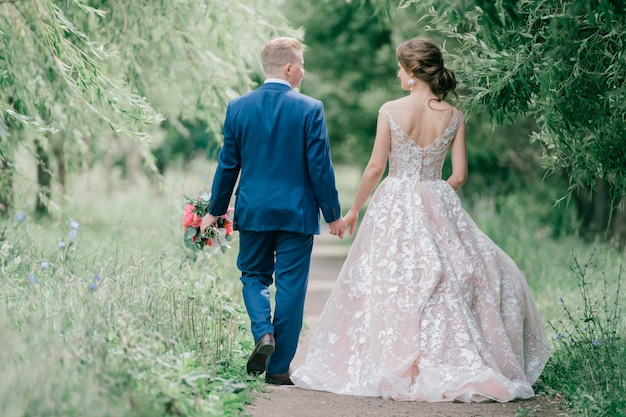 Beautiful wedding couple portrait from behind at nature
