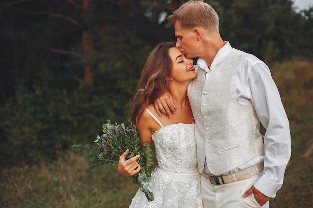 Beautiful wedding couple in a summer field