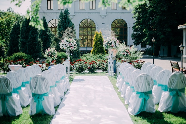 Beautiful wedding day ceremony set up. outdoor.