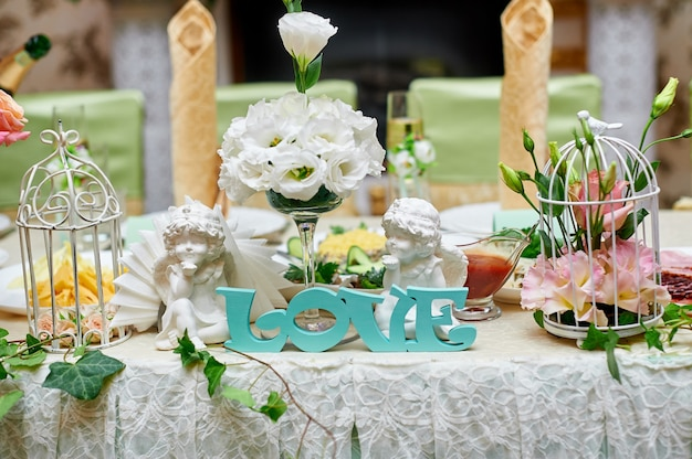 Beautiful wedding decorations of flowers on a table in the restaurant.