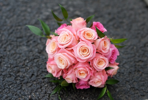 Beautiful wedding flowers bouquet (made of roses) on dark