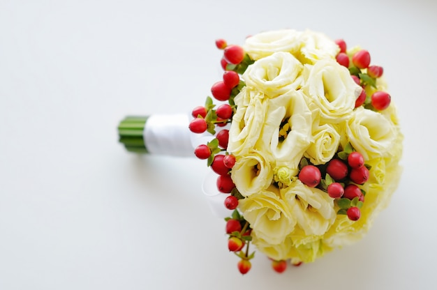 Beautiful wedding flowers bouquet on white