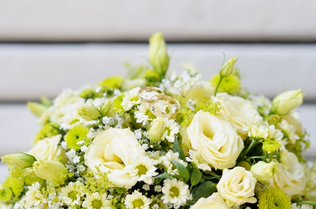 Beautiful wedding flowers bouquet with two wedding rings