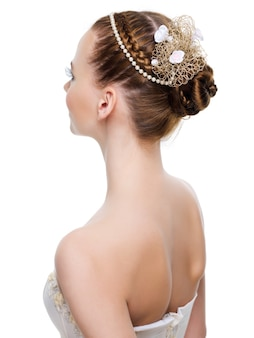 Beautiful wedding  hairstyle from pigtails. on