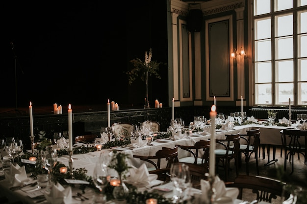 Beautiful wedding reception hall with a decorated luxury table setting
